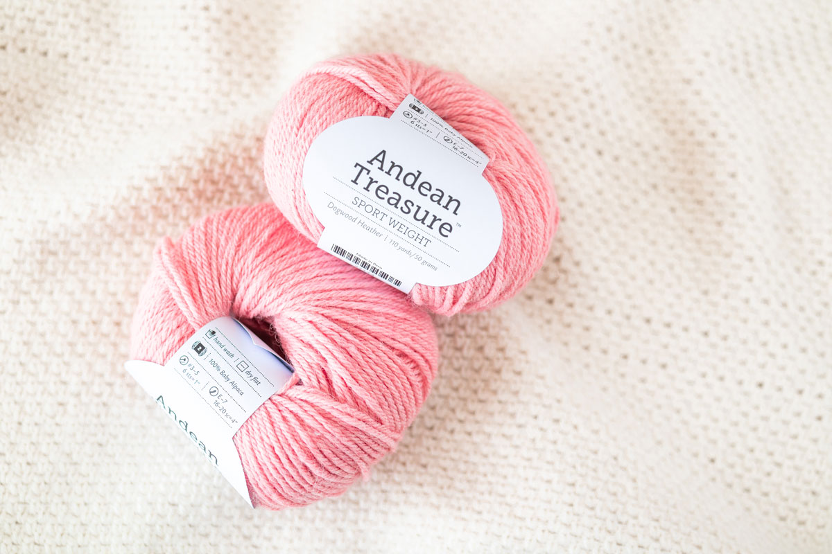 flat lay of baby alpaca yarn in wecrochet knitpicks andean treasure in peach pink coral shade dogwood heather