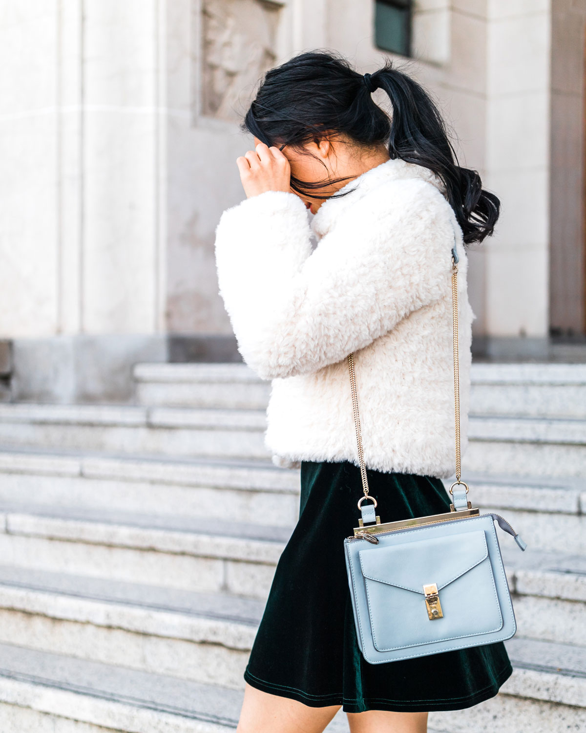 model wearing hand made crochet faux fur jacket DIY with baby blue handbag