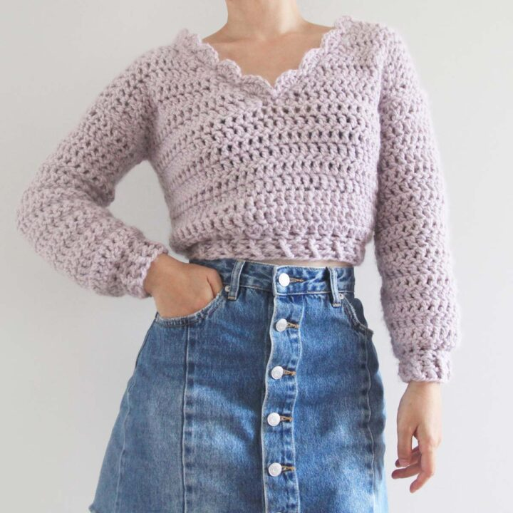 lilac pink super chunky cropped crochet sweater with denim skirt