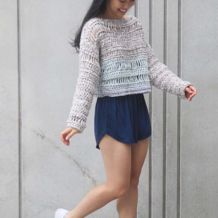 crochet beach sweater in beige, mint and baby blue with navy shorts