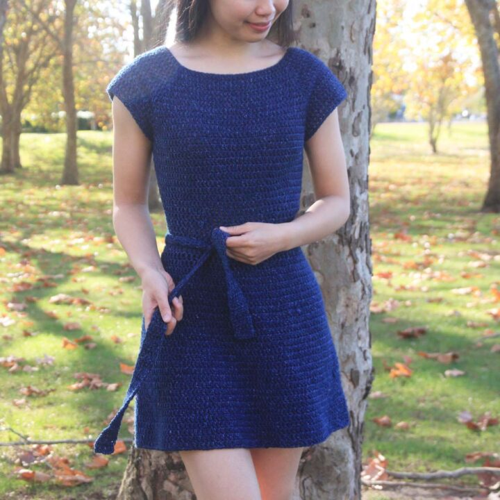 woman wearing blue crochet dress with cap sleeves