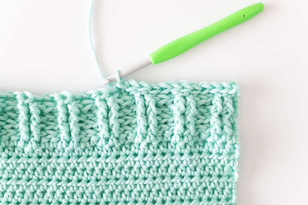 close up on back loop half double crochet ribbing on sweater hem