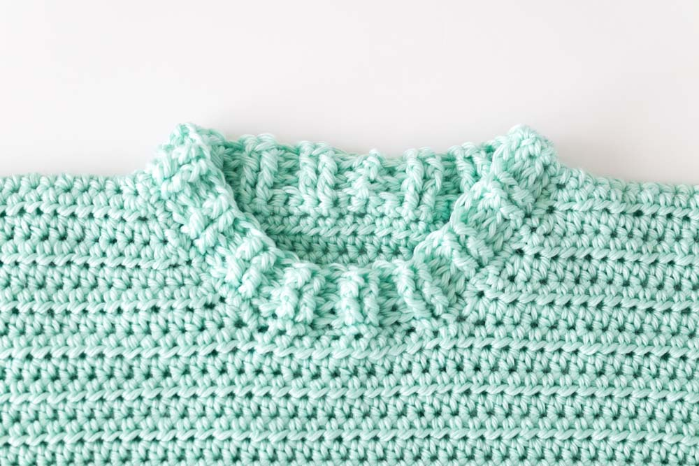 front post and back post half double crochet ribbed collar on mint crochet jumper