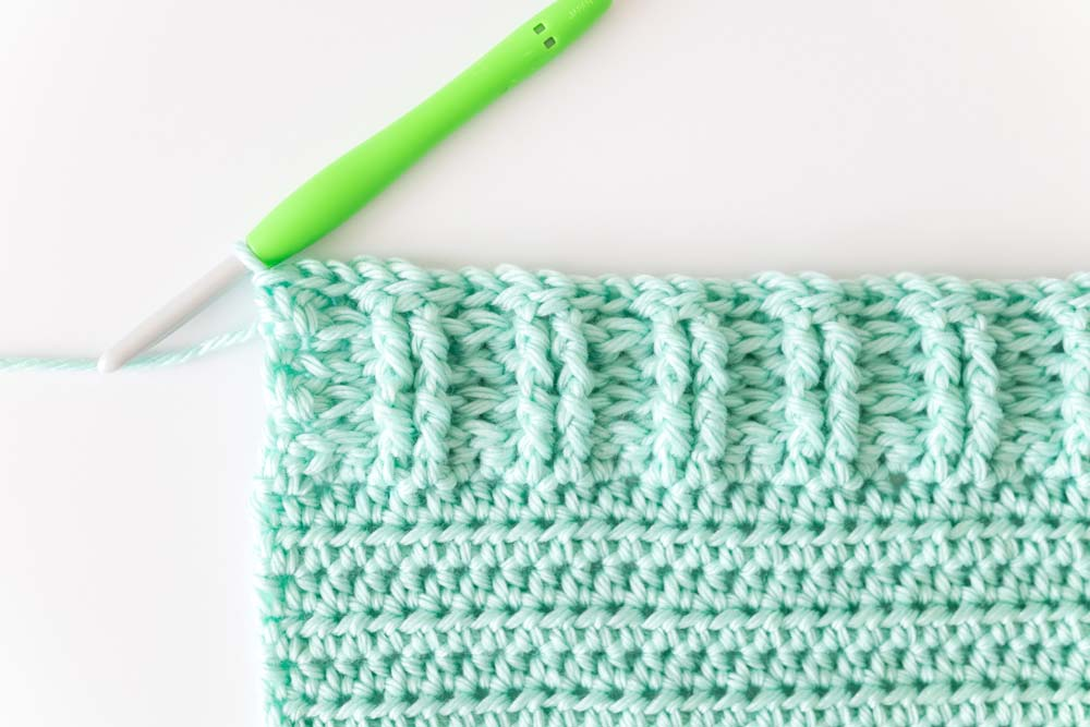 slip stitch edging on ribbed crochet pullover hem