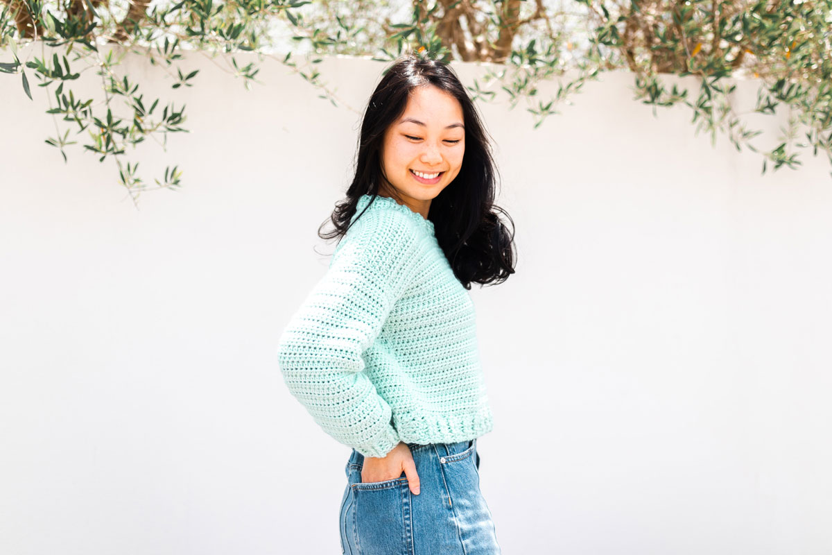 side view of mint crochet pullover with ribbed collar and hem