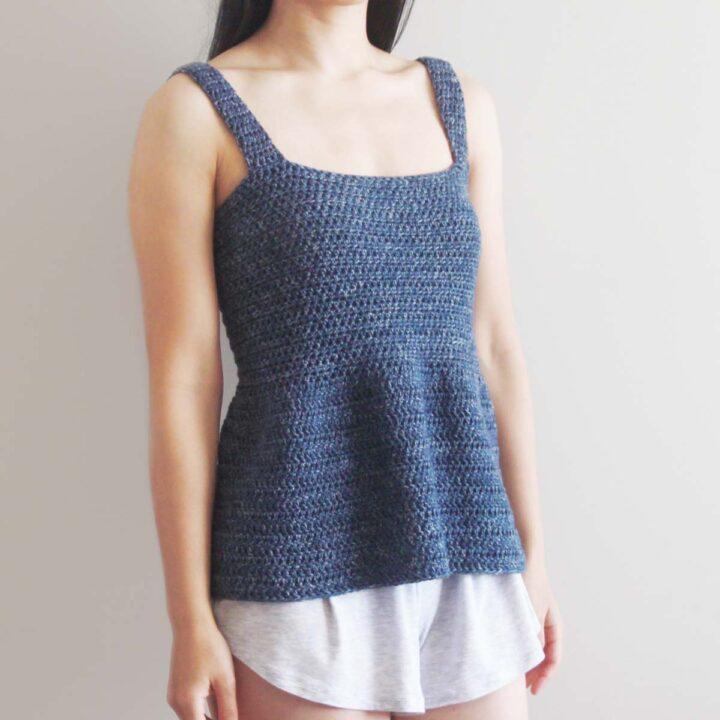 woman wearing blue denim cotton crochet tank top with grey shorts