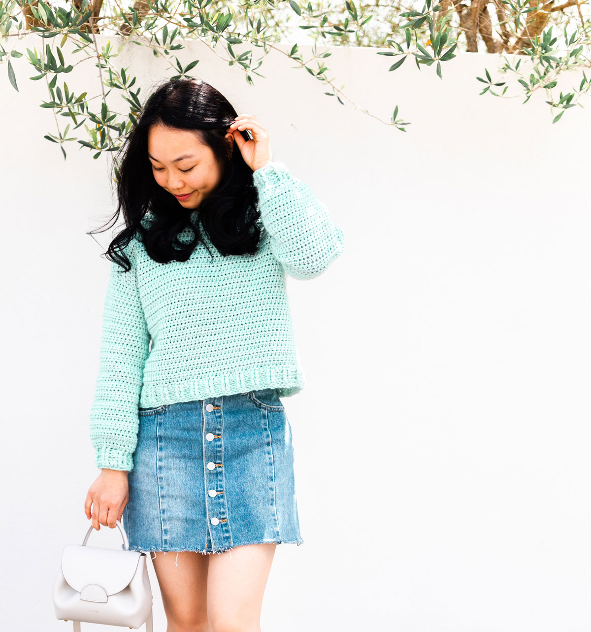 woman wearing hand made crochet pullover with ribbed hem