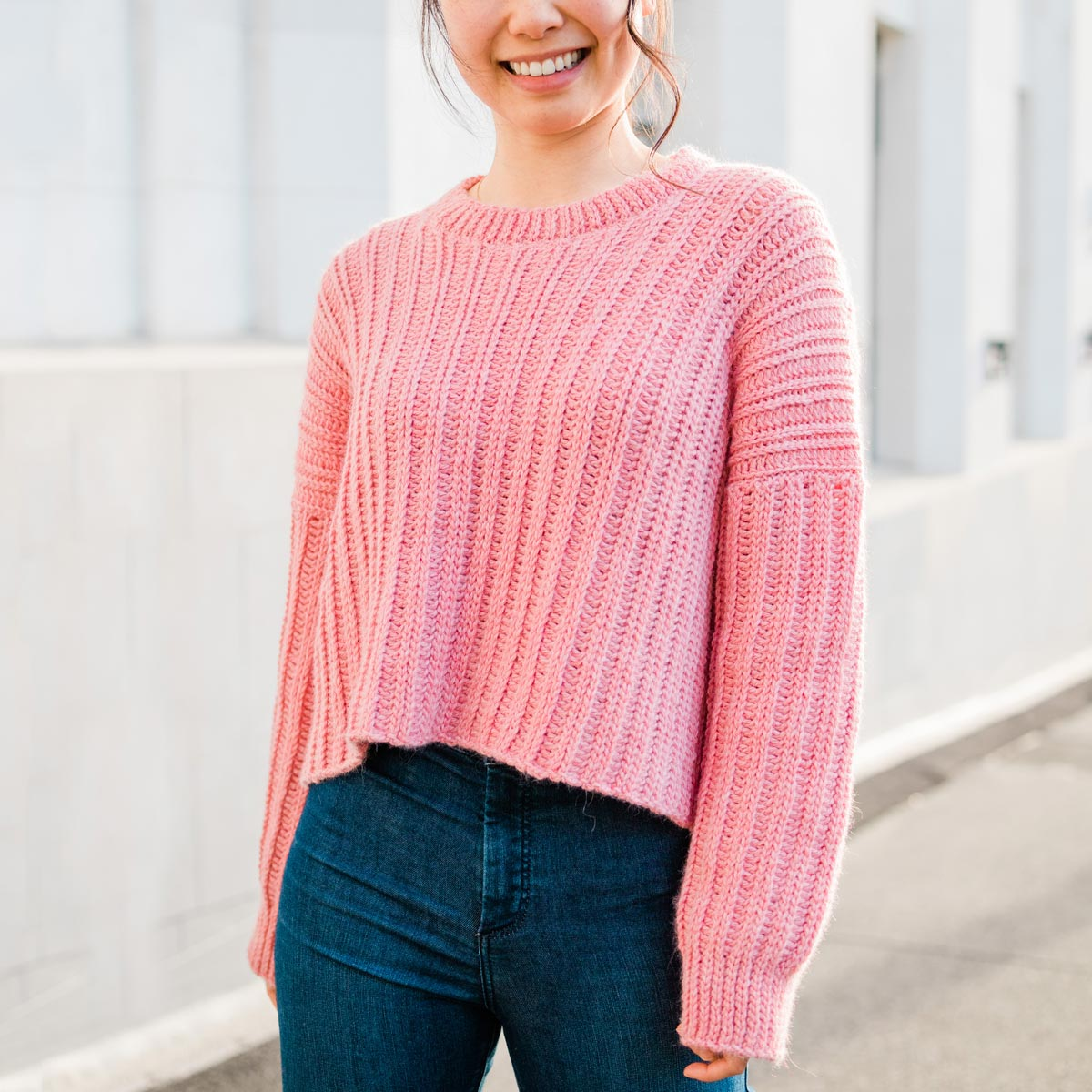 pink ribbed ccropped rochet sweater with loose sleeves