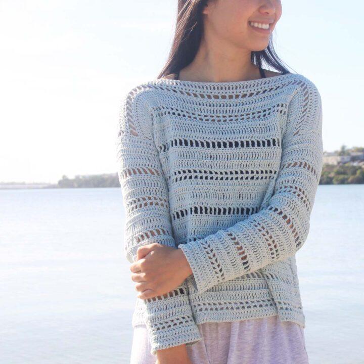 mesh summer crochet pullover crocheted with thin light blue cotton yarn