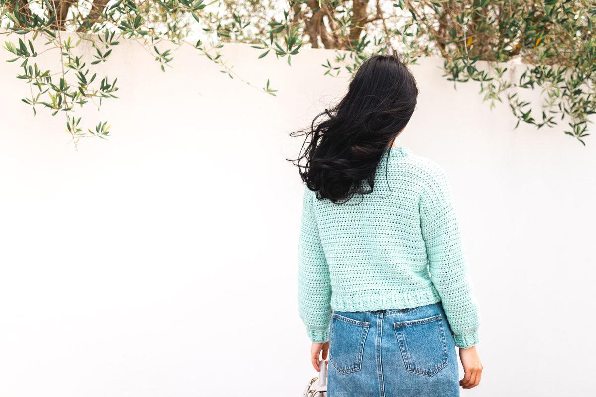 back view of simple crochet sweater with front and back post half double crochet ribbing
