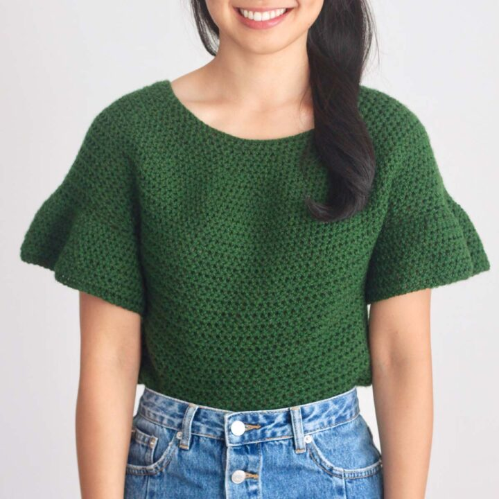 top down crochet sweater top with ruffle sleeves crocheted in paintbox yarns simply aran acrylic yarn