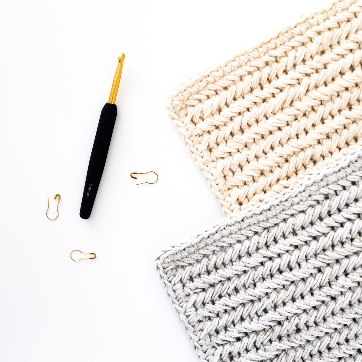 close up on herringbone single crochet stitch using cotton dishie yarn with gold crochet hook and gold stitch markers