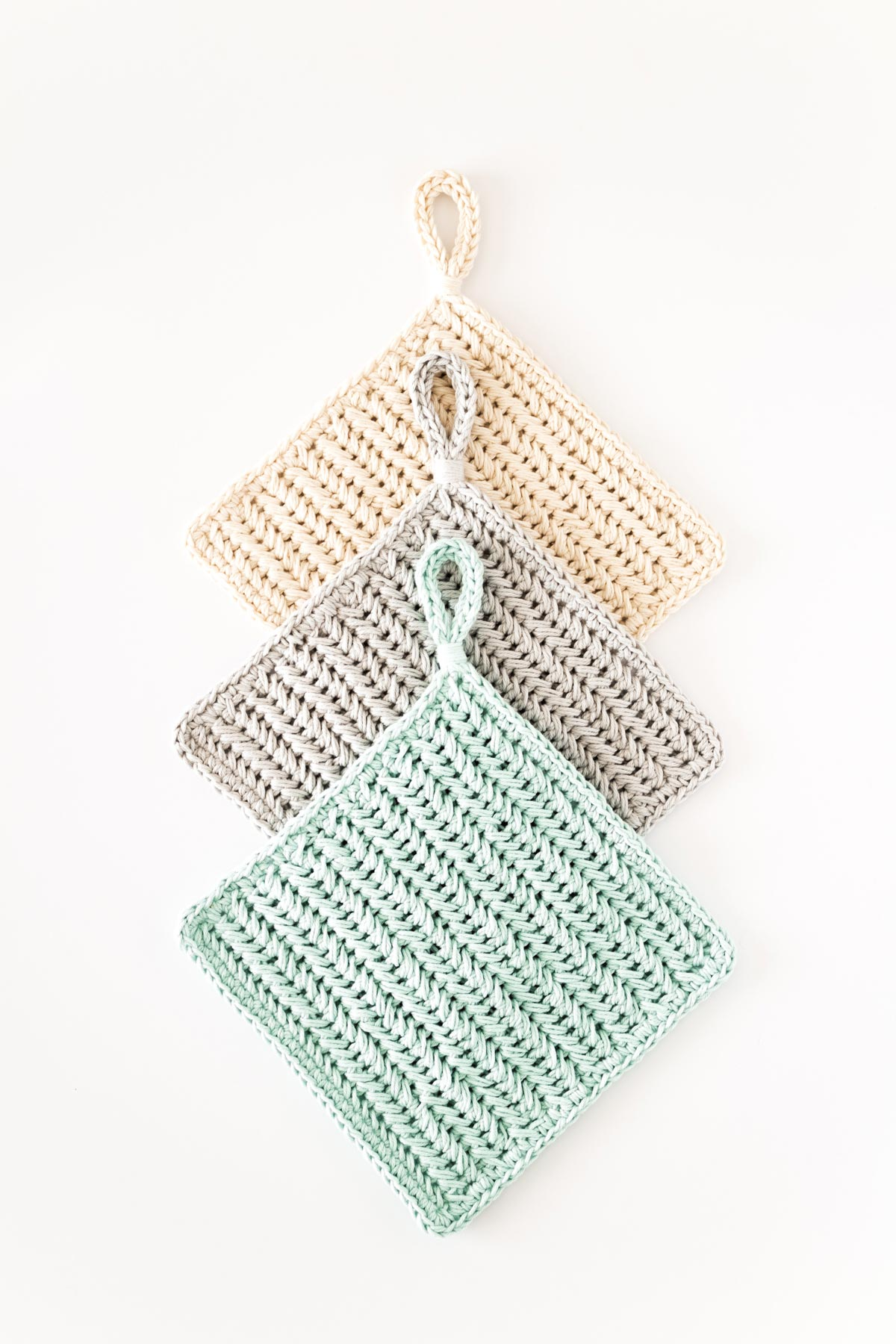 3 crochet pot holders in chevron single crochet stitch with loop handle in cream, light grey and mint cotton yarn