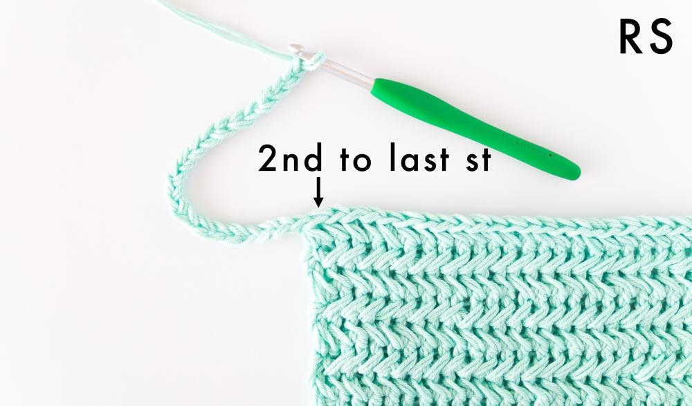 crochet chains forming loop handle on crochet pot holder