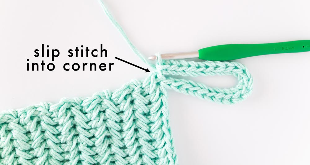 crochet chain loop attached to corner of pot holder