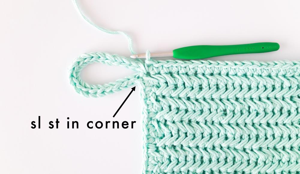 slip stitch worked in corner of crochet pot holder