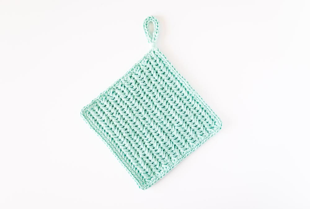 flat lay of crochet chevron pot holder with loop handle