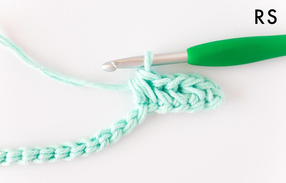 right side close up on herringbone single crochet chevron stitch in mint green cotton yarn