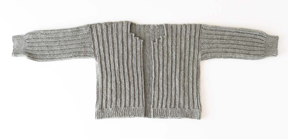 hemline ribbing sewn onto crochet oversized cardigan