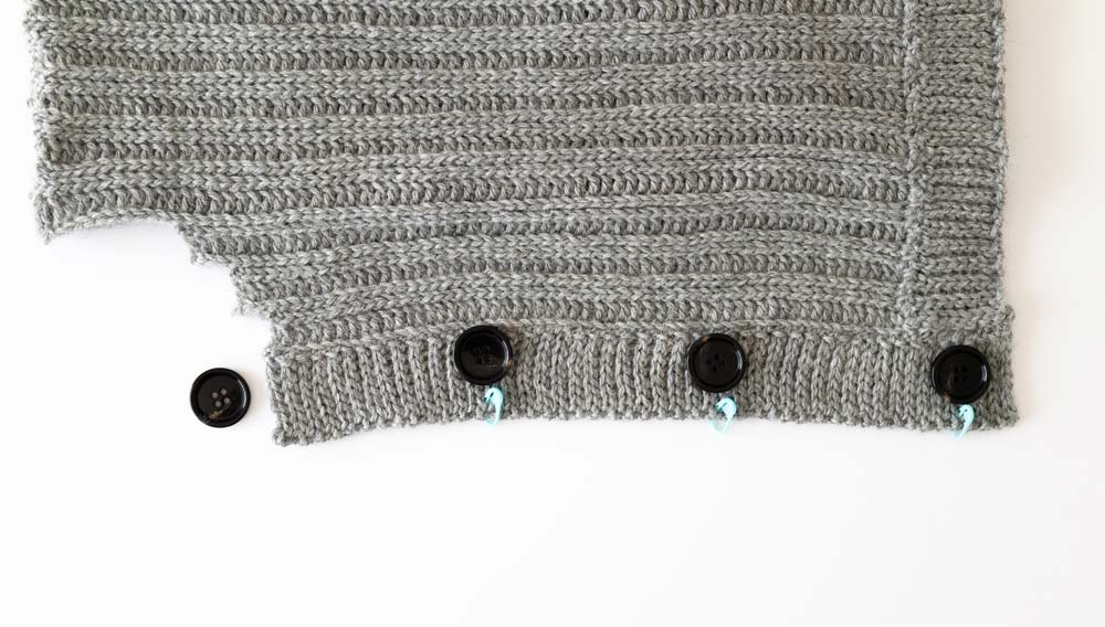 stitch markers inserted into cardigan ribbing to mark button placement