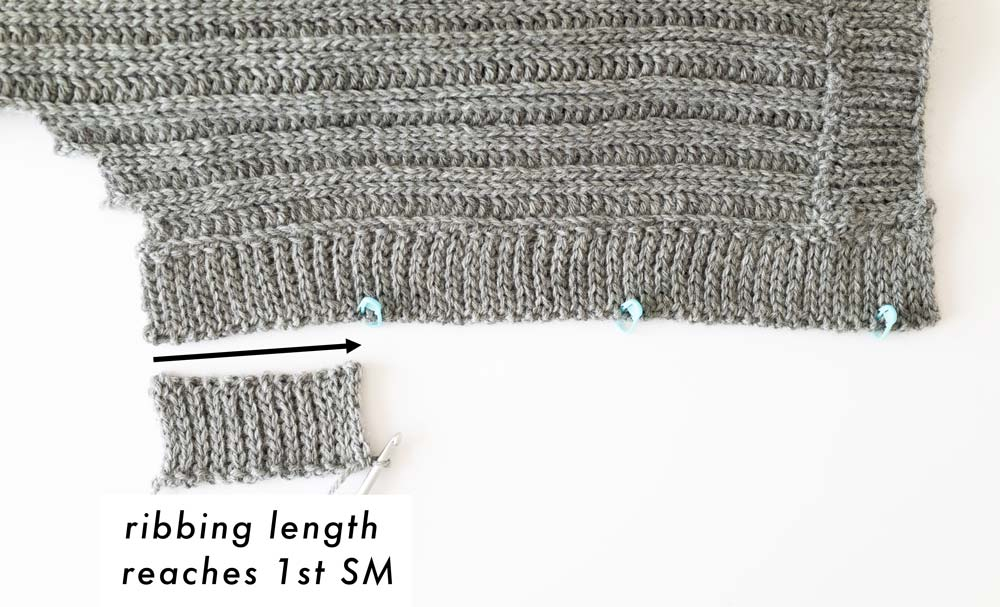 ribbing length reaches first SM along cardigan opening