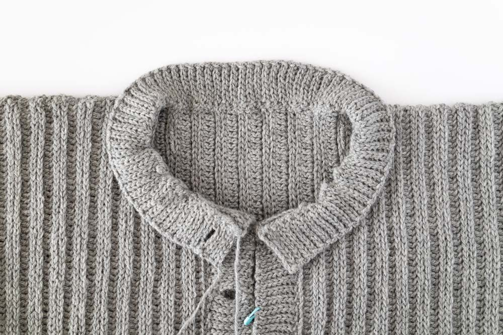 back loop slip stitch crochet ribbing sewn onto round neck oversized cardigan