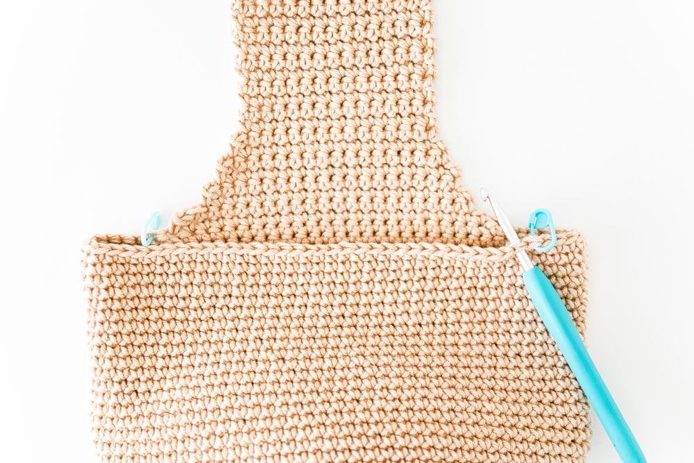 crochet hook inserted along edge of bag