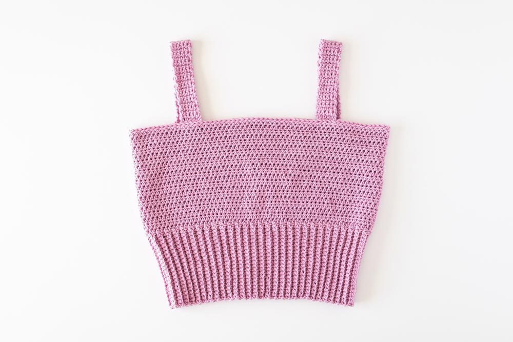 flat lay of finished crochet square neck crop top with ribbed hem