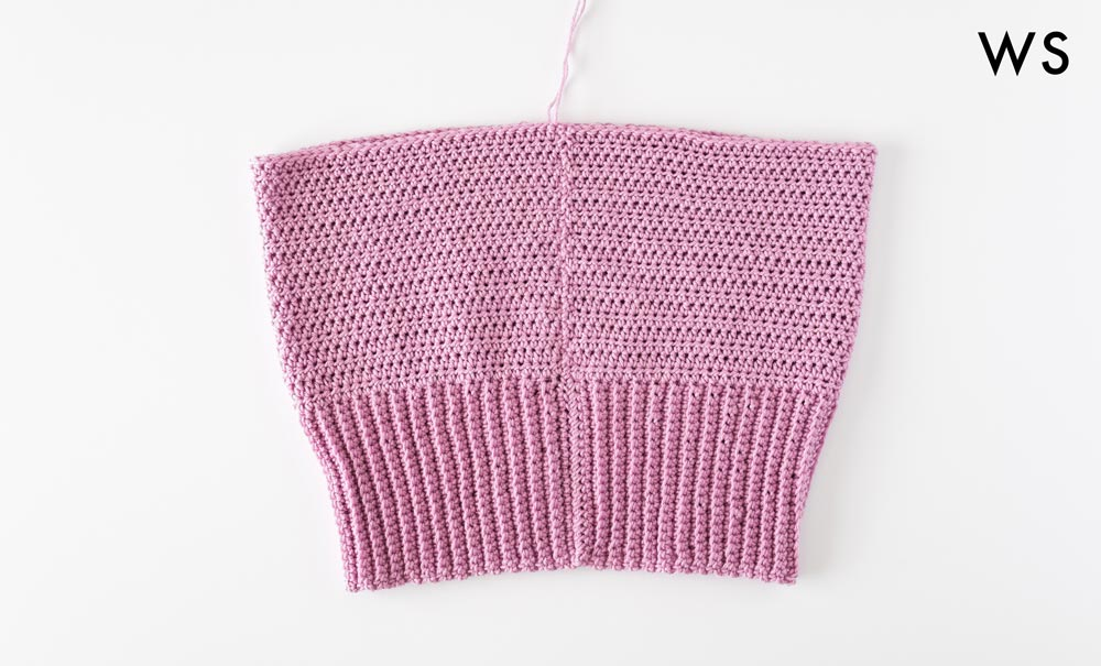 crochet crop top whip stitched together with wrong side facing outwards