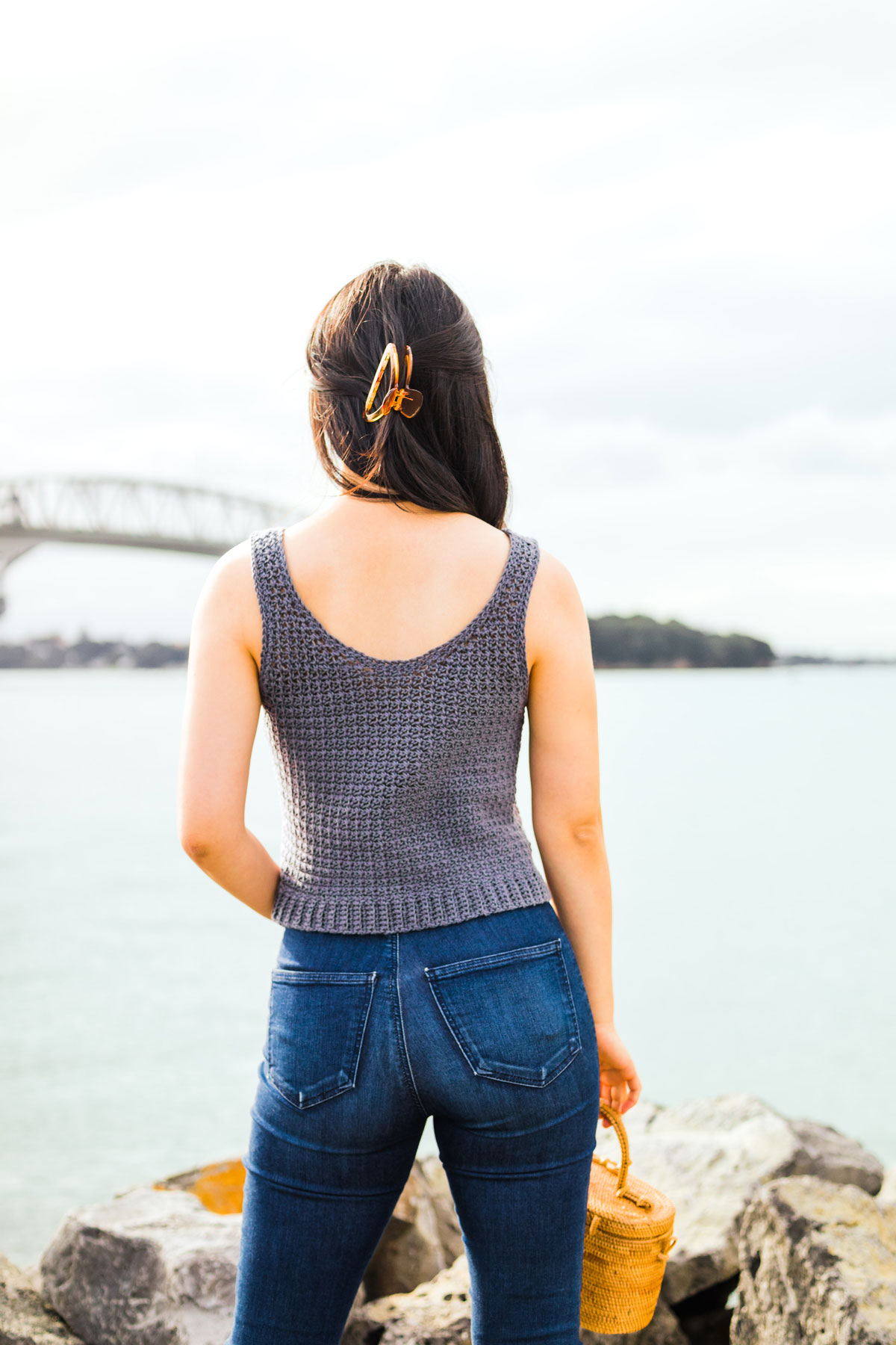 back view of model wearing grey mesh tank top with claw clip in hair