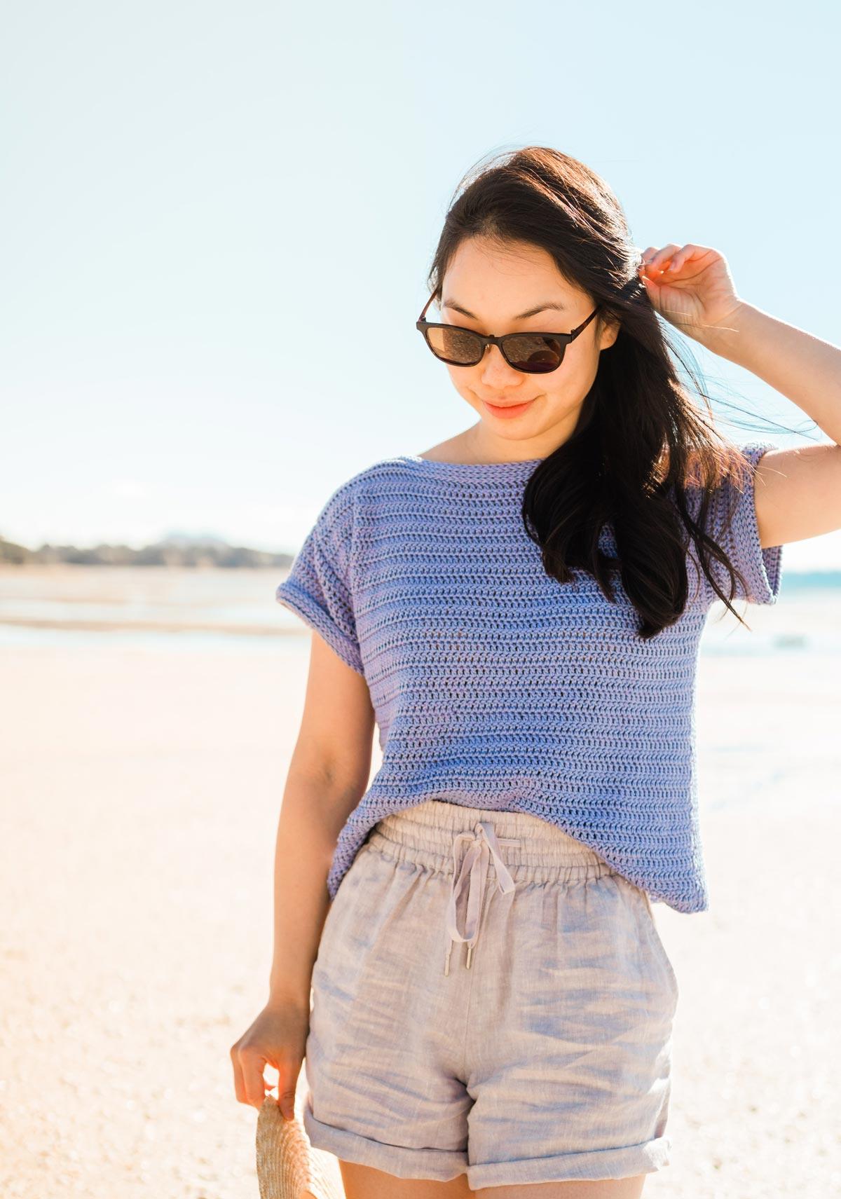 model wearing purple cotton crochet shirt with beige linen shorts