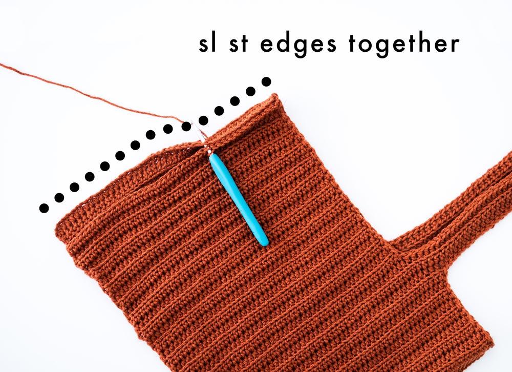 edges of crochet crop top back panel slip stitched together
