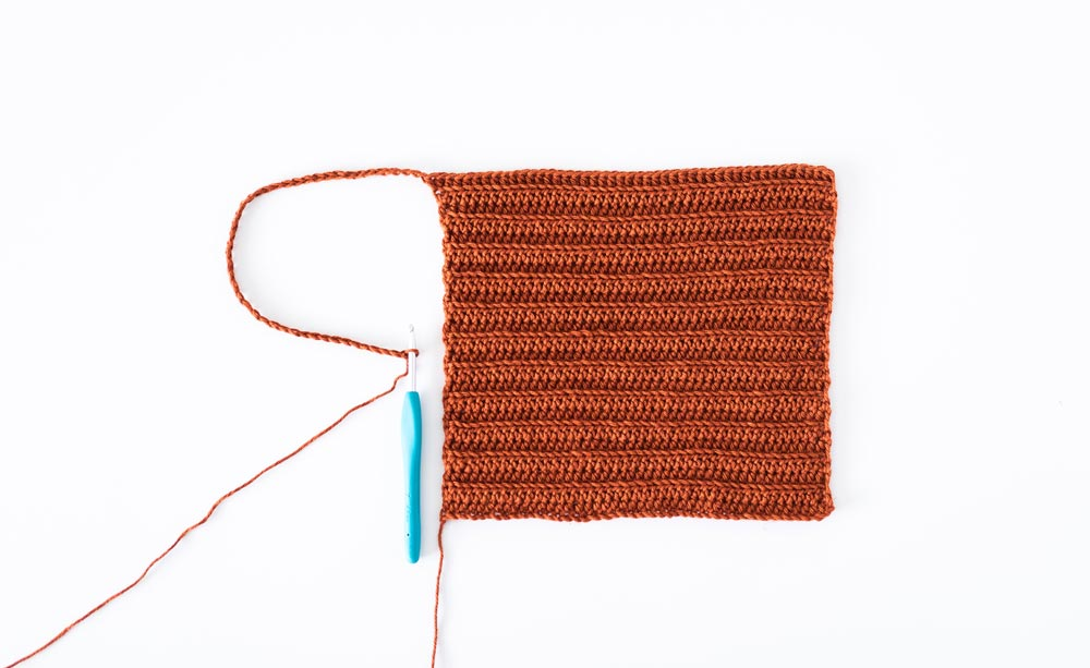 chain folded to show length of crochet crop top strap