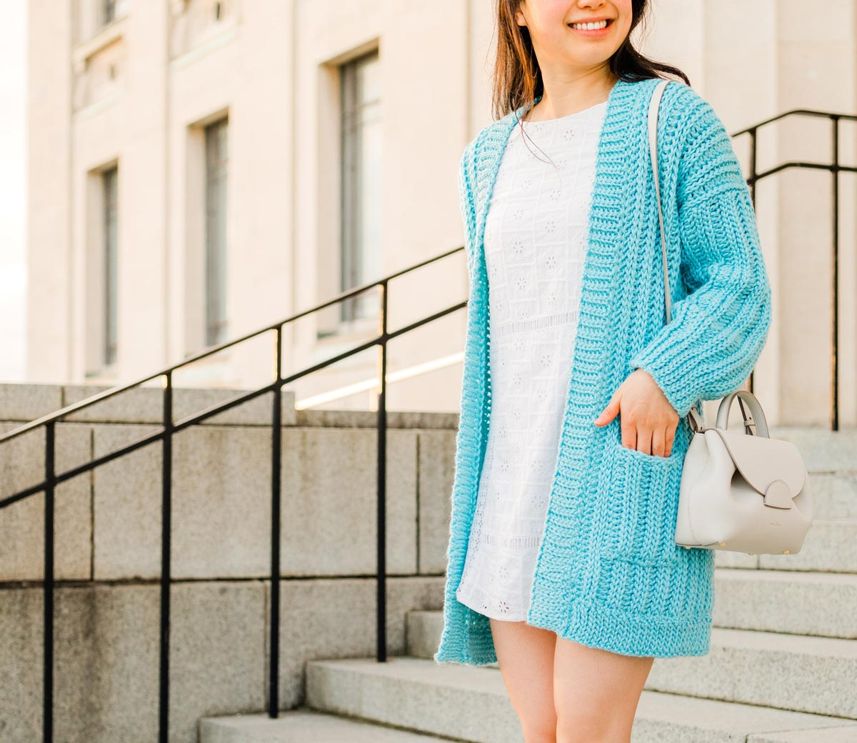 woman with hand in pocket of ribbed crochet cardigan for fall