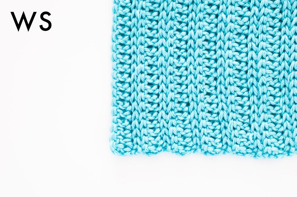 wrong side of crochet knit-like ribbing stitch in sky blue mighty stitch yarn