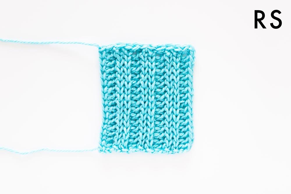 finished ribbed pocket with crochet slip stitch edging