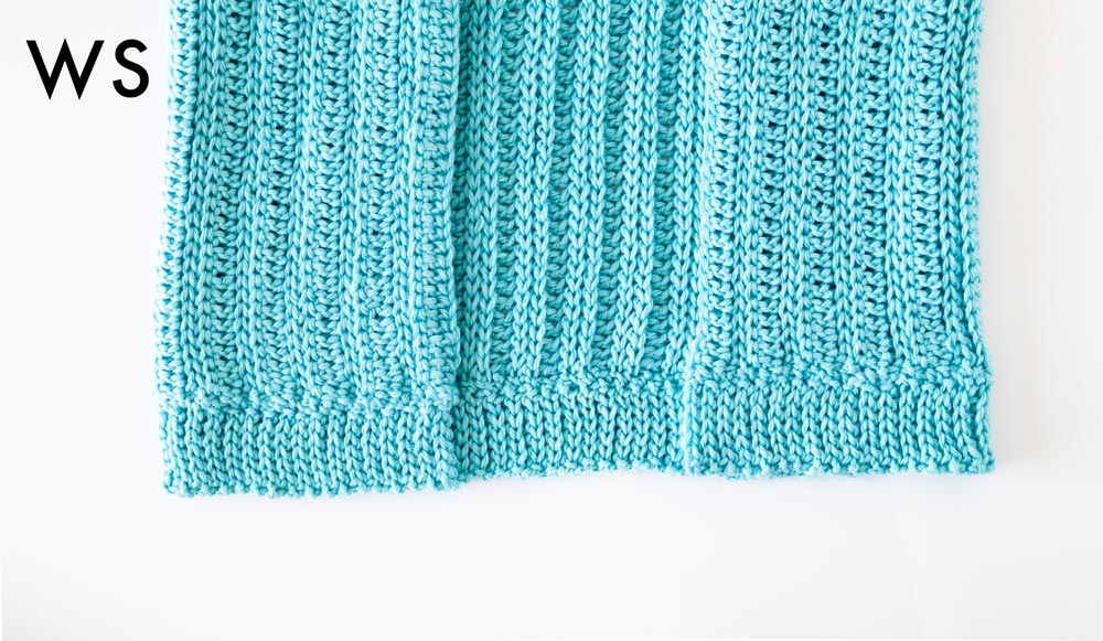 crochet ribbing attached to hemline of cardigan
