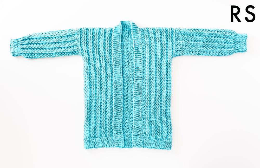 flat lay of oversized ribbed crochet cardigan