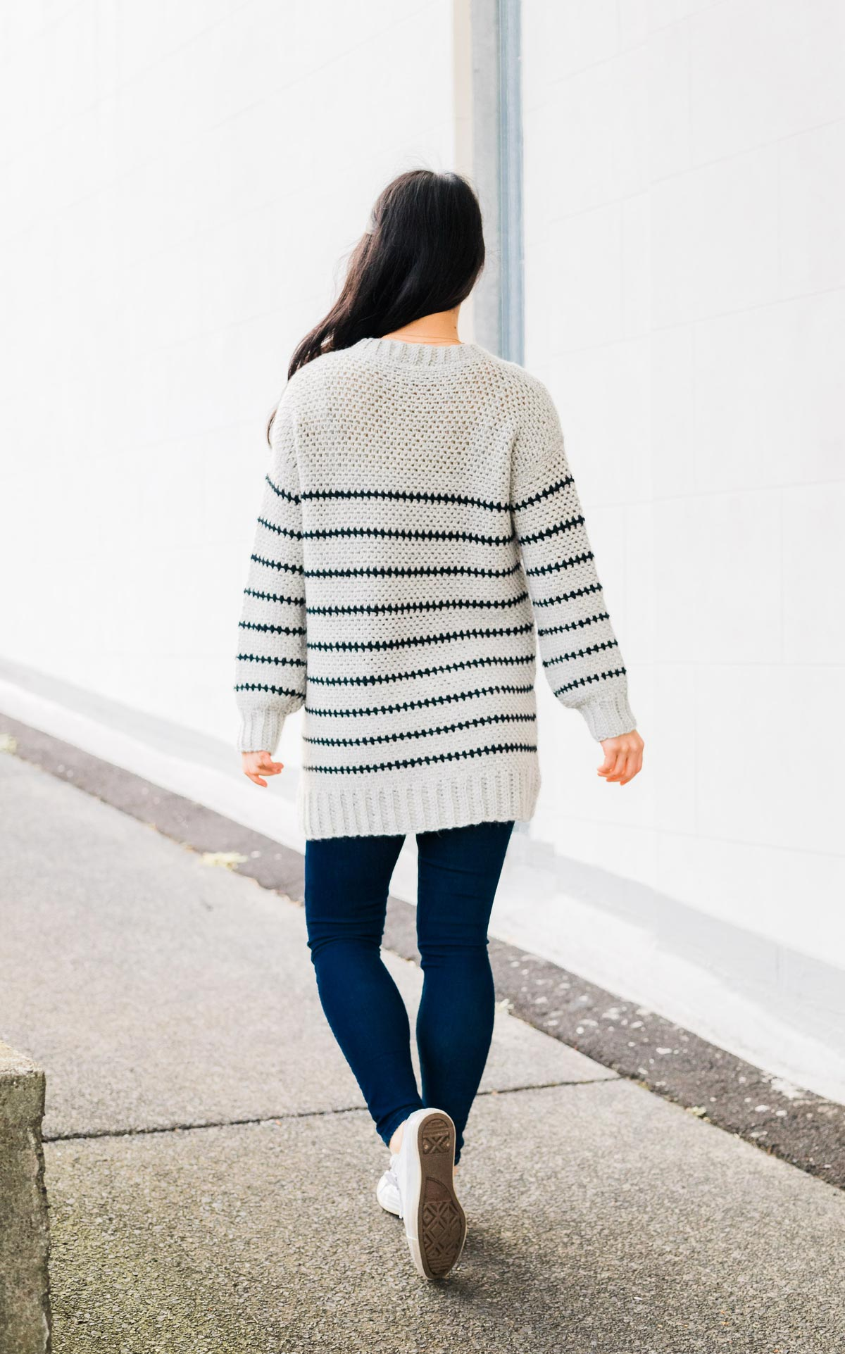 back view of long stripe crochet pullover