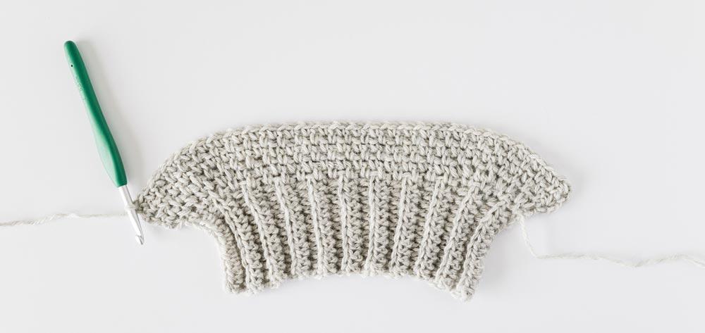 moss stitch crochet sleeve in grey baby alpaca yarn