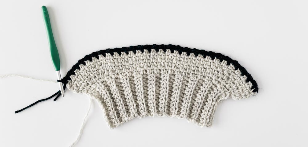 contrast navy stripe on crochet sleeve
